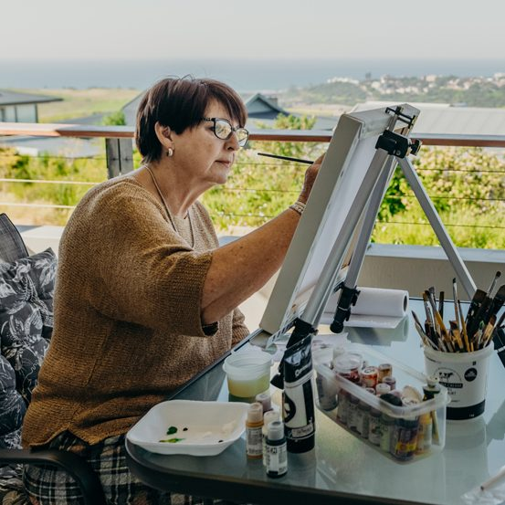 Renishaw Hills resident painting on her balcony